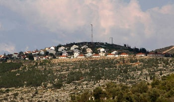A general view shows the Jewish settlement of Itamar on a hilltop overlooking the West Bank village of Awarta near Nablus March 12, 2011.