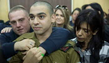 Sgt. Elor Azaria waits with his parents for the verdict inside the military court in Tel Aviv, Israel, Janary 4, 2017.