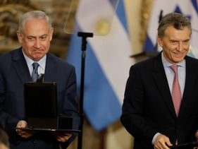 Israeli PM Benjamin Netanyahu receives a box with digital documentation of the Holocaust from Argentina's President Mauricio Macri. Buenos Aires, Argentina. Sept. 12, 2017
