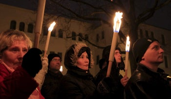 Demonstrators participate in a protest organized by a Jewish group against a planned statue of Balint Homan in Székesfehérvár, Hungary, December 13, 2015.