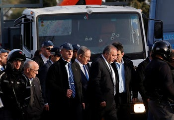 Prime Minister Netanyahu and Defense Minister Lieberman visit the scene of the truck-ramming in Jerusalem, January 8, 2017.