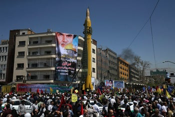 A Ghadr H surface-to-surface ballistic missile is displayed by Iran's Revolutionary Guard in an annual pro-Palestinian rally marking Jerusalem Day, in Tehran, Iran, June 23, 2017. A portrait of the late Iranian revolutionary founder Ayatollah Khomeini and Jerusalem's Dome of Rock is in the background.