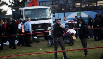 Israeli police at the scene of a truck-ramming attack that killed four soldiers in Jerusalem, January 8, 2017.