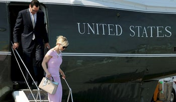 FILE PHOTO: U.S. Treasury Secretary Steve Mnuchin and his wife Louise Linton arrive on the Marine One helicopter with President Donald Trump aboard the deck of the aircraft carrier USS Gerald R. Ford for its commissioning ceremony at Naval Station Norfolk in Norfolk, Virginia, U.S. July 22, 2017