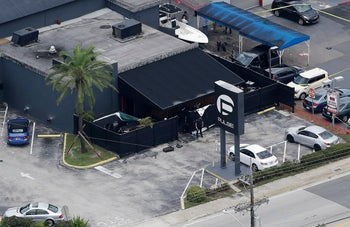 Law enforcement officials work at the Pulse gay nightclub in Orlando, Fla., following the a mass shooting, June, 2016.