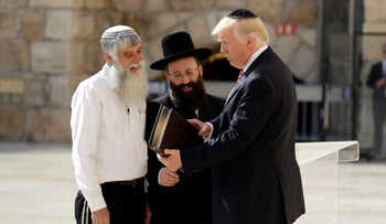 "President Donald Trump visits the Western Wall accompanied by Shmuel Rabinovitch, Rabbi of the Western Wall and Mordechai ""Suli"" Elias, director of the Western Wall Heritage Foundation during Trump's trip to Israel on May 22, 2017."