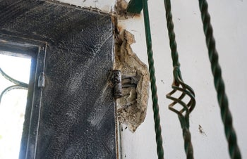 The damage caused to Abu Kharma's home.