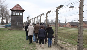 Palestinian scholar Prof. Mohammed Dajani Daoudi leading the visit by a group of Palestinian students to Auschwitz death camp, March 2014.