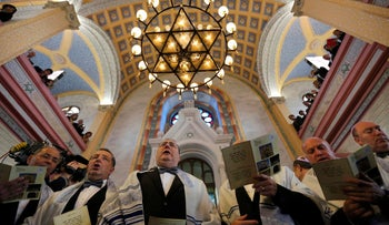 Jewish community members attend the re-opening ceremony of the Great Synagogue in Edirne, Turkey, March 26, 2015.