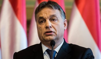 Viktor Orban, Hungary's prime minister, speaks during a news conference at the national parliament in Budapest, Hungary, on Thursday, Dec. 18, 2014.