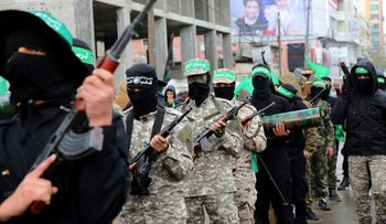 Masked Palestinian militants from Hamas's armed wing mark the group's 29th anniversary on December 14, 2016.