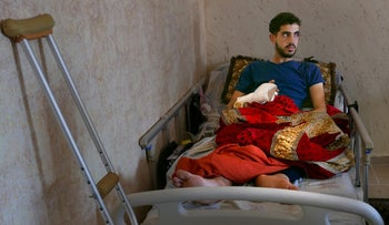Mohammed Amassi, wounded, at home this week.
