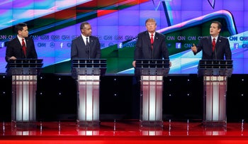 Ted Cruz, right, speaks during an exchange with Marco Rubio, left, as Ben Carson, second from left, and Donald Trump look on during the CNN Republican presidential debate at the Venetian Hotel & Casino on Tuesday, Dec. 15, 2015, in Las Vegas.