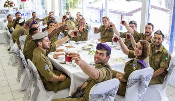 Lone soldiers at a seder in Ashkelon last year