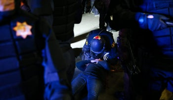A police medic provides care to a supporter of conservative commentator Ben Shapiro after she was knocked to the ground during a scuffle with protesters, September 14, 2017 at UC California, Berkeley.