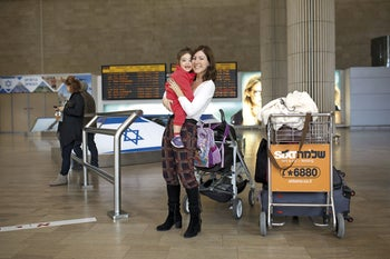 Moran Foox Elder, 33, and her daughter Meshi, 2 and a half, embrace at the airport.