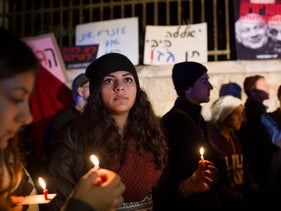 A rally held against the gas deal in Jerusalem. Protesters hold candles.