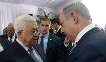Israeli Prime Minister Benjamin Netanyahu, right, with Palestinian President Mahmoud Abbas at the funeral of former Israeli President Shimon Peres in Jerusalem, Sept. 30, 2016.