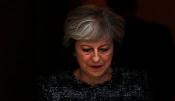 Britain's Prime Minister Theresa May leaves 10 Downing Street to attend Prime Minister's Questions, in London, September 13, 2017.