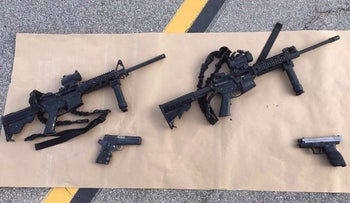 Weapons confiscated from the attack in San Bernardino, California are shown in this San Bernardino County Sheriff Department handout photo from their Twitter account, December 3, 2015.