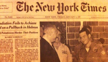 A January 1997 cover of the New York Times depicting Netanyahu and IDF Lieutenant Avi Buskila shaking hands, after Buskila helped stop a Jewish terrorist in Hebron.