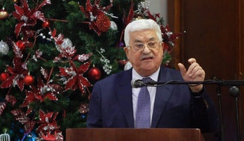 Abbas speaks during a Christmas lunch with members of the Christian Orthodox community on January 6, 2017, in Beit Sahur, near Bethlehem.