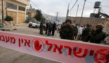 Israeli forces at the scene of an attack, where a Palestinian stabbed an Israeli soldier before he was shot dead, in Hebron, September 17, 2016.
