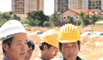 Chinese construction workers in Israel.