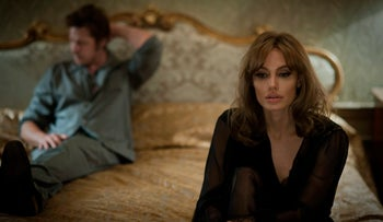 """This photo provided by Universal Pictures shows, Brad Pitt, left, as Roland and Angelina Jolie Pitt as Vanessa in a scene from the film """"By the Sea,"""" directed by Jolie Pitt."""