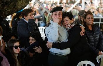 Family and friends of Yael Yekutiel mourn her death at her funeral in a military cemetery in Kiryat Shaul, January 9, 2017.