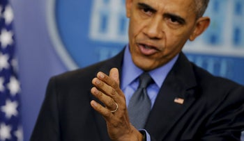 U.S. President Barack Obama gestures as he holds his end of the year news conference at the White House in Washington, December 18, 2015.