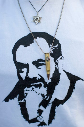 A supporter of Israeli soldier Elor Azaria, convicted of manslaughter, wears a shirt depicting Meir Kahane, the founder of the Jewish Defense League and the Kach party.