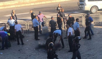 Security forces operate at the site of a stabbing attack near Herod's Gate in Jerusalem's Old City, September 19, 2016.
