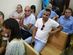 Former IDF deputy chief Maj. Gen. (res.) Uzi Dayan (right) and Elor Azaria and his family at the Jaffa Military Court, September 19, 2016.