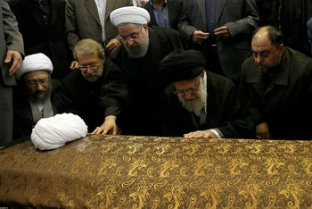 Iran's Supreme Leader Ayatollah Ali Khamenei and Iran's President Hassan Rouhani touch the coffin of former president Ali Akbar Hashemi Rafsanjani during his funeral ceremony in Tehran, Iran January 10, 2017.