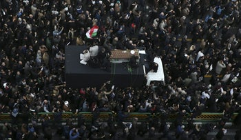 The coffin of former Iranian President Akbar Hashemi Rafsanjani, is carried on a truck surrounded by mourners during his funeral in Tehran, Iran, Tuesday, Jan. 10, 2017.