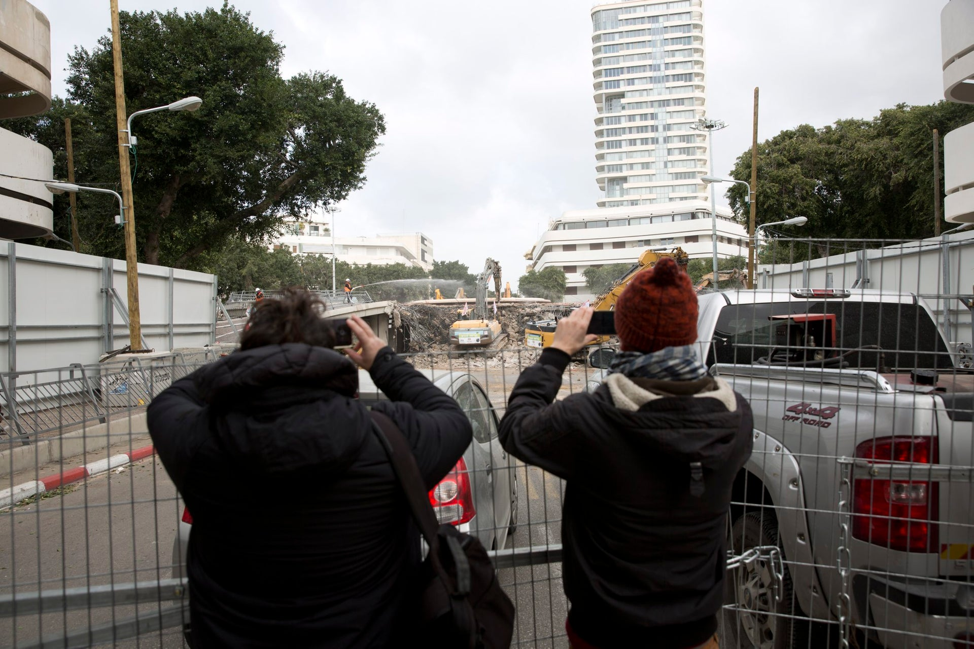 People take pictures as Bulldozers working on the lowering of Dizengoff Square, January 9, 2017.