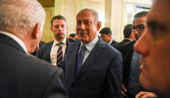 File photo: Israeli Prime Minister Benjamin Netanyahu (C) leaves after a meeting with businessmen in Buenos Aires, on September 12, 2017.