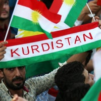 Iraqi Kurds fly Kurdish flags during an event to urge people to vote in the upcoming independence referendum in Arbil, the capital of the autonomous Kurdish region of northern Iraq, on September 16, 2017.