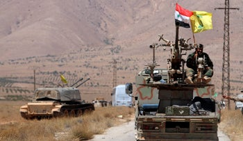 Hezbollah and Syrian flags on a military vehicle in Western Qalamoun, Syria, August 2017.