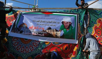 Palestinians put up a memorial tent and poster in Jabal Mukkaber for Fadi al-Qanbar, who rammed his truck into a group of Israeli soldiers, killing four, Jan. 9, 2017.