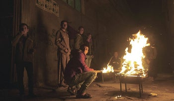 Palestinians gather around a fire during a power cut in the Al-Shati refugee camp in Gaza City, on January 4, 2017