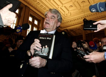 """Right-wing British historian David Irving holds his book """"Hitler's War"""" when arriving at a court in Vienna, on Monday, Feb. 20, 2006. Irving is accused of denying the Holocaust and is facing up to 10 years in jail. He has been in custody since his arrest in November on charges stemming from two speeches he gave in Austria in 1989 in which he was accused of denying the Nazis' extermination of 6 million Jews."""