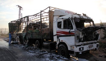 A damaged truck carrying aid on the outskirts of the Syrian city of Aleppo after a convoy was hit by a deadly airstrike, September 20, 2016.