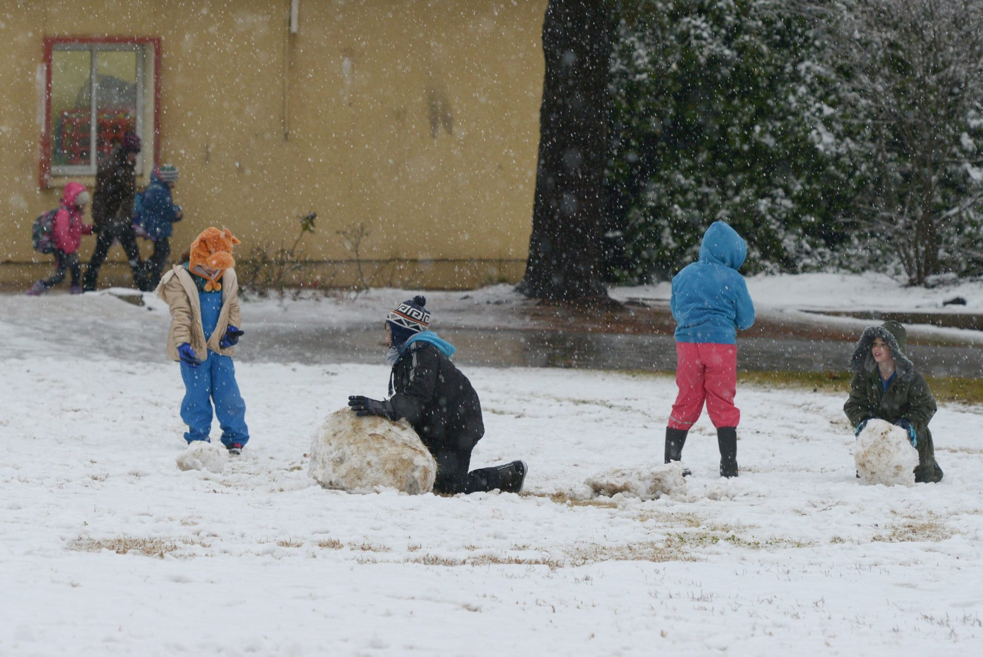Children play in the snow in Kibbutz Merom Golan, January 9, 2017.