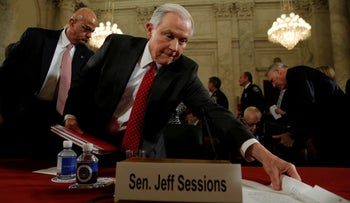 U.S. Sen. Jeff Sessions (R-AL) grabs his papers during a break from a Senate Judiciary Committee confirmation hearing for Sessions to become U.S. attorney general on Capitol Hill in Washington, U.S., January 10, 2017.