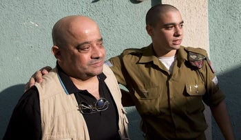 Charlie Azaria, left, and his son Elor Azaria at the military court in Jaffa, October 2016.