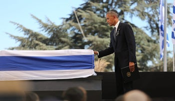 U.S. President Barack Obama places his hand on Shimon Peres' coffin at his funeral in Jerusalem, September 30, 2016.