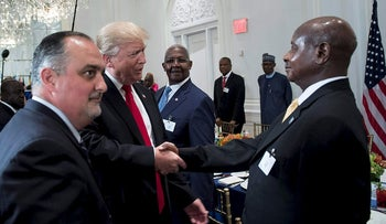 US President Donald Trump (C) greets Uganda's President Yowri Kaguta Museveni (R) before a luncheon with US and African leaders at the Palace Hotel during the 72nd United Nations General Assembly on September 20, 2017 in New York