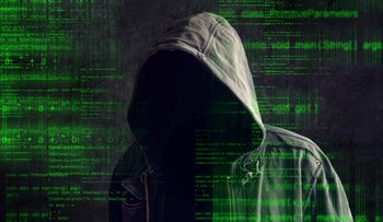An illustrative image of a computer hacker.